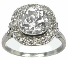 Art Deco 2.55ct Diamond Platinum Engagement Ring,  The ring is centered by a stunning old mine cut diamond that weighs 2.55ct and is EGL certified. The color of the diamond is H-I with SI1 clarity. The center diamond is accentuated by approximately 0.80ct of smaller old mine cut diamonds.