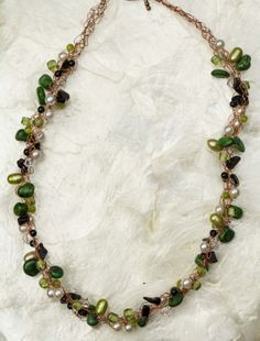Shades of Green on Copper Wire Crochet by DancingLoonJewelry, $60.00    I've come to love mixing colored freshwater pearls with other stones and beads to create texture and color.  This necklace blends green and white freshwater pearls, white crystal pearls, onyx, glass beads and crystals all together.