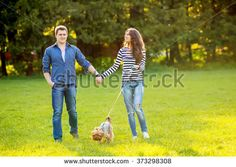 stock-photo-lifestyle-happy-couple-of-two-walk-on-a-sunny-day-in-the-park-with-a-dog-373298308.jpg (450×320)
