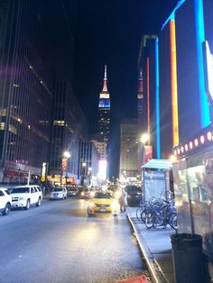 Empire State building on wintry December night with Madison Square Garden