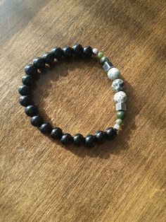 Elastic Bracelet for man made of semi-precious stones of onyx and african jade . Bracelets For Men, Beaded Bracelets, Stone Bracelet, Boutique, Jade, Gemstones, Etsy, African, Jewelry