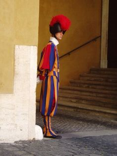 A Swiss Guard ribbon pieces, 30 hours to make and weighs 8 lbs. kilo) They guard St Peter's Basilica (and perhaps the pope!) in Vatican City. Michelangelo Pieta, Le Vatican, Swiss Guard, World Of Warriors, St Peters Basilica, Sistine Chapel, Chicago Tribune, Roman Catholic, Countries Of The World