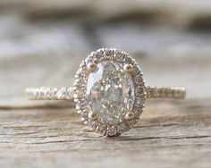 This is my new favorite Etsy store. Not just for the diamonds either. Everything is beautiful. 1.02 Ct. Oval Diamond Engagement Ring in 14K Yellow by Studio1040, $3980.00
