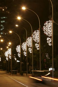 Lamp posts look striking when decorated with lacy LED lights that are reminiscent of snow flakes.