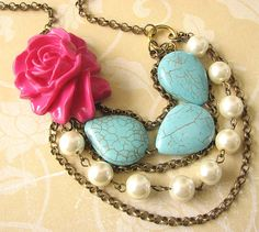 Flower statement necklace  with turquoise stones, pearls, and that pretty pink rose.  The piece (especially  the chain) looks almost antique to me.