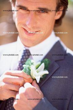 http://www.photaki.com/picture-bridegroom-adjusting-buttonhole_1323470.htm