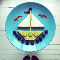 sailboat made up of breakfast food on plate