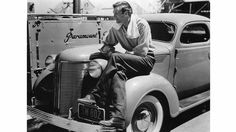 Actor Gary Cooper with his new Chrysler. Paramount studios, Hollywood, 1937