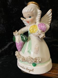 """November Birthday Angel by Napco China, numbered A1371.  Embellished with spaghetti  ruffles on her cuffs and bottom of her gown.   Stands 4.5"""" and in excellent condition. Birthday Angel, November Birthday, To My Daughter, Snow Globes, Ruffles, Spaghetti, Gown, China, Etsy"""