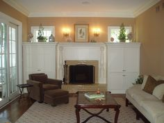 Custom Home by Thomas Homes. Family Room Built-In Bookcases with transom windows above.