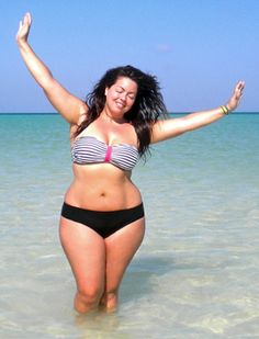 I'm size 18. I would never wear a bikini, but I wish I was as confident as her!