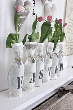 Cover your plain glass vases with simple linen wine bags accented with bits of lace and stencil. Any holiday really
