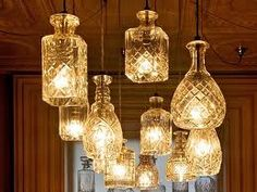 Light fixtures made from old wine decanters-really elegant and unique!
