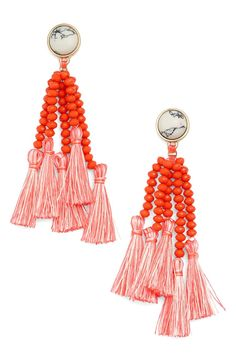 Coral-hued fringe lends a colorful Mediterranean vibe to these trend-right beaded tassel earrings. They're topped with beautifully marbled stone cabochons for even more pizzazz.