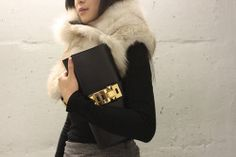 Large clutches look great in simple colours and by teaming it with a top in the same colour is very chic....x