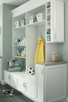 Mudroom Organization At Its Best Aristokraft S Winstead Maple Doors In White Contrast Nicely With Kitchen Cabinets