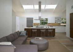 KITCHEN WITH VAULT-Bertoia Counter Stools in kitchen of Los Angeles renovation by Montalba Architects.