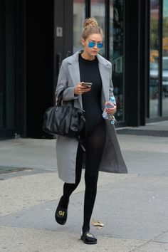 Gigi Hadid wearing Ray-Ban Rb3025 Crystal Blue Aviator Metal Sunglasses and Elizabeth and James Scott Duffel Bag in Black Crosshatch Leather