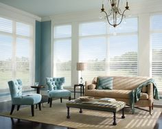 LOVE the way the windows are framed with crown molding.  MUST do this.  + silhouette shades from Hunter Douglas