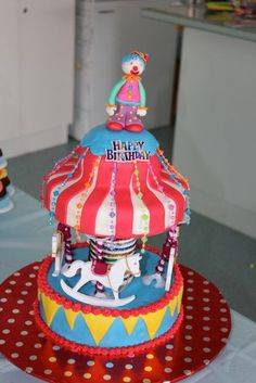 My little ones circus carousel cake with fondant clown topper :)