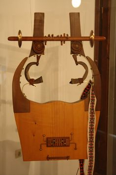 "Ancient Greek Kithara - The cithara or kithara was an ancient Greek musical instrument in the lyre or lyra family. In modern Greek the word kithara has come to mean ""guitar"" (a word whose origins are found in kithara)."