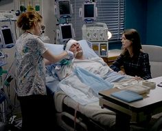 A Nurse is removing everything on Derek as Meredith watch
