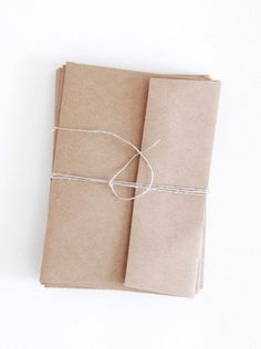 I have searched far and wide to bring the perfect kraft brown paper envelopes to Supply Paper Co. Simple and utilitarian, but still just a little bit special. These envelopes have a crisp straight flap. Pack of 10 tied up with string.