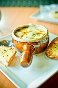French onion soup: who wouldn't love this French home cooked recipe/ Sprinkled with delicious French cheese; just cuddle up next to that fire with your loved one and listen to Edith :-)