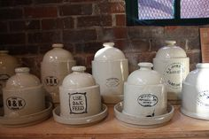 Great collection of antique stoneware chicken feeders with advertising.