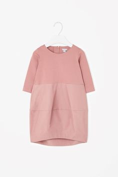 This dress has a body made from soft stretchy cotton blend and textured finish cotton skirt. Designed with a rounded voluminous shape, it has a graduated hemline, in-seam pockets and a hidden back zip. Little Fashion, Kids Fashion, Baby Girl Fashion, Little Girl Dresses, Girls Dresses, Moda Kids, Kind Mode, Kids Wear, Dress Patterns