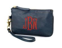 We love a Wristlet purse, add nautical navy to the trends with this monogram purse!