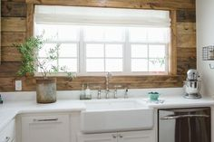 HGTV's Fixer Upper invites you to peek at this renovated kitchen with a white farmhouse sink and brown shiplap backsplash. Decor, House, Home, Kitchen Remodel, Fixer Upper, Shiplap Backsplash, Home Kitchens, Backsplash Designs, Kitchen Living