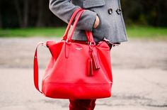 Red bag and a gray peacoat.