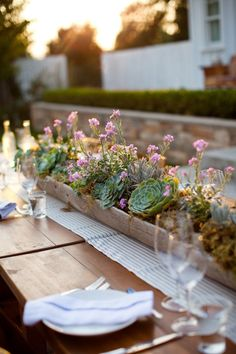 rustic planter with planted succulents,flower wedding centerpieces