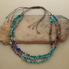"""From Sundance. Blue-green turquoise, aquamarine, iolite and lapis alternate with sponge coral, carnelian, pink sapphire, sunstone and pink quartz, accented with sterling beads. Strung on brown cord with a macrame closure, each strand adjusts in length, to wear wrapped together or in a cascade. Handcrafted exclusively for Sundance. 18"""" to 32""""L."""