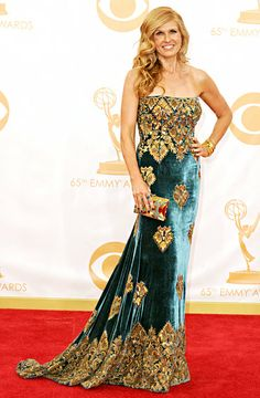 Connie Britton wore an embroidered blue strapless velvet Naeem Khan gown and Cathy Waterman jewelry at the 2013 Emmys.
