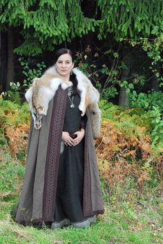 I like the wide trim on this cloak- a dull fabric color is brought to life with it. Dull colors of wool are often much more affordable.