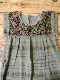 This gorgeous hand woven embroidered top was made by skilled artisans in Oaxaca, Mexico and purchased by me using fair trade practices. I then hand