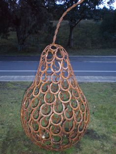 Beautiful outdoor sculpture of a pear made from welded horse shoes. Seen at Lake Crackenback, Snowy Mountains NSW, Australia ツ