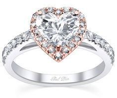 Heart-shaped diamond engagement ring just means love, love, love.