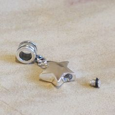 Star Memorial Charm for holding ashes, hair or soil.  Especially designed to be worn on large hole bead bracelets.