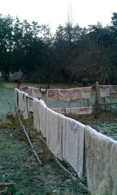 Vintage Feed Sacks Hung on the Garden Fence