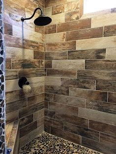 Wood look tile shower with pebble floor