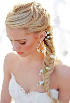 Bride's fishtail braid wedding hair ideas Toni Kami Wedding Hairstyles ♥ ❶ adorned with daisies