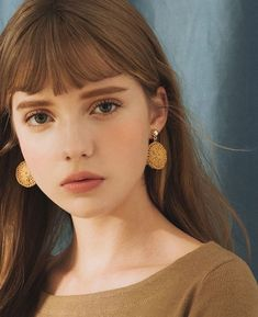 bangs and gold accessories #beauty