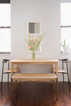Pin for Later: This Gallery-Inspired Studio Apartment Proves Small Is Special  Julia's CH88 dining chairs by Carl Hansen & Son had a central role in the design.