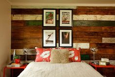 Cozy beach style bedroom with a striking accent wall in wood