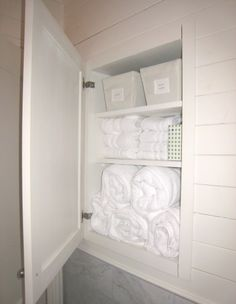 To make up for the storage space lost by not having a vanity cabinet, the contractor stole some space from the cabinets in my bedroom and snuck some linen storage behind the door.