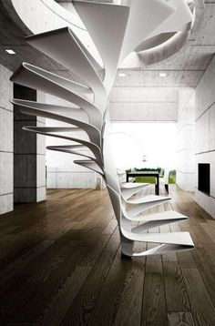 This futuristic spiral white staircase adds an element to this space that is simply out of this world! A minimalist design, this stairway is the highlight of the room.
