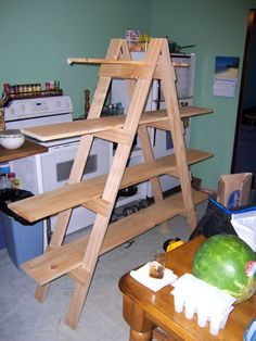 Your Own Ladder Shelf for your Craft Show Display DIY Tutorial to make your own ladder display shelfs. We think this is perfect for displaying candles!DIY Tutorial to make your own ladder display shelfs. We think this is perfect for displaying candles! Christmas Village Display, Christmas Villages, Christmas Decorations, Christmas Houses, Ladder Christmas Tree, Ladder Display, Display Shelves, Display Ideas, Booth Ideas